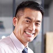 システムグループグループ長の顔イメージ写真